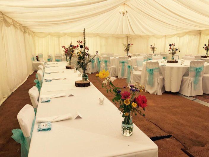 Bride & groom table inside marquee